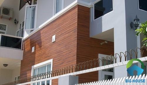 gạch vân gỗ ốp tường mặt tiền 1